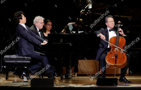 Pianists Lang Lang, left, and Emanuel Ax, center, perform with cellist Yo-Yo Ma during Carnegie Hall's 125th Anniversary Concert, in, New York