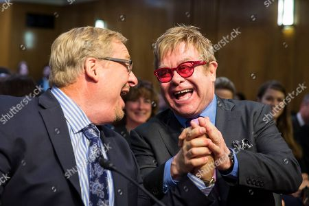 Rick Warren, Elton John. Musician Sir Elton John, right, greets Dr. Rick Warren on Capitol Hill in Washington, prior to testifying before the Senate State, Foreign Operations, and Related Programs subcommittee in support of U.S. funding for global HIV/AIDS treatment