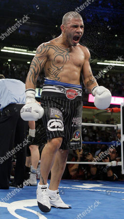 Miguel Cotto, Yuri Foreman. Miguel Cotto, of Puerto Rico, reacts after knocking down Yuri Foreman during the ninth round of a WBA light middleweight title match, at Yankee Stadium in New York. Cotto won the fight with a ninth round TKO