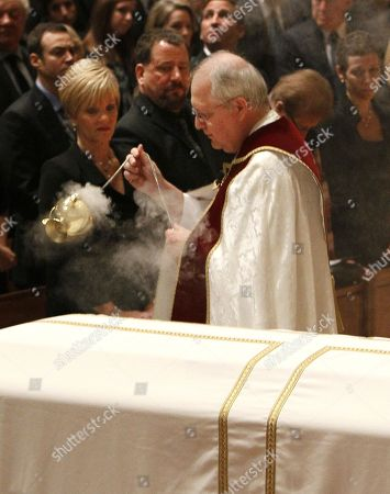 Ron Santo, Vicki Santo, Daniel G. Mayall. Vicki Santo, left, wife of Chicago Cub's great Ron Santo, watches as Monsignor Daniel G. Mayall blesses Santo's casket during funeral services at Holy Name Cathedral in Chicago. The nine-time all-star died Dec. 2 in an Arizona hospital from complications of bladder cancer. He was 70