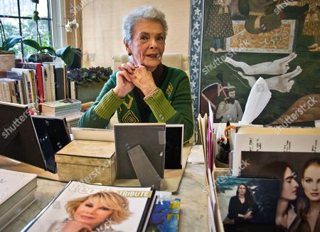 "Personal shopper Betty Halbreich, 86, poses at her office desk at Bergdorf Goodman in New York. She lays out her life in a new book, ""I'll Drink to That: A Life in Style with a Twist,"" co-written by Rebecca Paley"