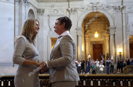 Sandy Stier, Kris Perry. Sandy Stier, left, exchanges wedding vows with Kris Perry during a ceremony presided by California Attorney General Kamala Harris at City Hall in San Francisco, . Stier and Perry, the lead plaintiffs in the U.S. Supreme Court case that overturned California's same-sex marriage ban, tied the knot about an hour after a federal appeals court freed same-sex couples to obtain marriage licenses for the first time in 4 1/2 years
