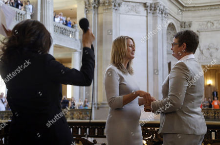 Sany Stier, Kris Perry, Kamala Harris. California Attorney General Kamala Harris, left, reacts after conducting the wedding vows of Sandy Stier, center left, and Kris Perry, at City Hall in San Francisco, . Stier and Perry, the lead plaintiffs in the U.S. Supreme Court case that overturned California's same-sex marriage ban, tied the knot about an hour after a federal appeals court freed same-sex couples to obtain marriage licenses for the first time in 4 1/2 years