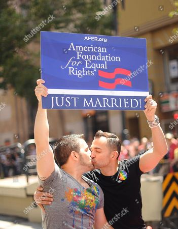 Paul Katami, Jeff Zarrillo. Proposition 8 plaintiffs Paul Katami, right, and Jeff Zarrillo kiss while riding in San Francisco's 43rd annual Gay Pride parade . The couple wed on Friday after a U.S. Supreme Court decision cleared the way for same-sex marriages in California