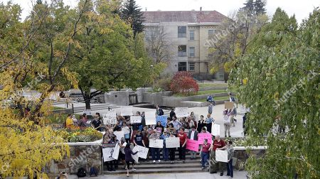 Students protest on the campus of Utah State, in Logan, Utah. Utah's campus gun laws are in the spotlight after feminist speaker Anita Sarkeesian canceled a speech at Utah State University once she learned the school would allow concealed firearms despite an anonymous threat against her