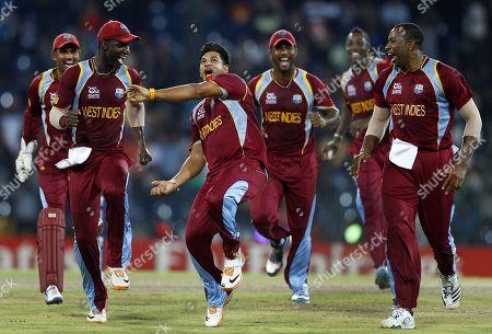 Ravi Rampaul, Darren Sammy. West Indies' bowler Ravi Rampaul, third left, and captain Darren Sammy, second left, celebrate with teammates the dismissal of Australia's batsman David Hussey, not seen, during the ICC Twenty20 Cricket World Cup semifinal match in Colombo, Sri Lanka