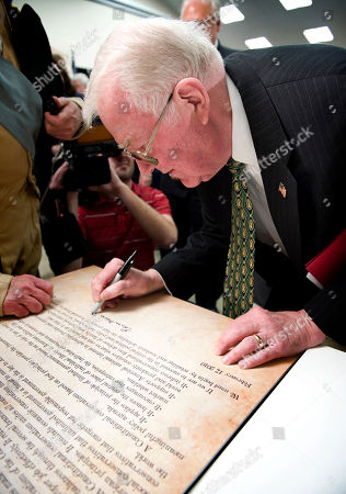 Former U.S. Attorney General Edwin Meese III, chairman of the Conservative Action Project, signs the Mount Vernon Statement during a ceremony at Collingwood Library and Museum in Alexandria, Va., . The document defines the principles, values and beliefs of the conservative movement