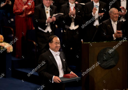 The 2012 Nobel Prize Laureate for Literature China's Mo Yan stands to the applause after receiving his Nobel Prize from Sweden's King Carl XVI Gustaf, not pictured, during the Nobel Prize award ceremony at the Stockholm Concert Hall in Stockholm, . The Nobel awards are always awarded on Dec. 10, the anniversary of Alfred Nobel's death in 1896. The prizes for laureates in medicine, chemistry, physics and literature are awarded in the Swedish capital Stockholm, whilst the Nobel Peace Prize is awarded on the same day in Oslo, Norway