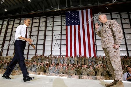Barack Obama, John Allen. Marine Gen. John R. Allen, commander of the International Security Assistance Force and U.S. Forces Afghanistan, introduces President Barack Obama before he addresses troops at Bagram Air Field, Afghanistan