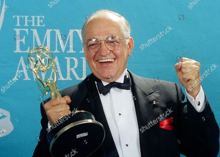"Actor Richard Dysart grasps the Emmy Award he won for Best Supporting Actor in a Drama Series for his role in ""L.A. Law"" during the 44th annual Emmy Awards in Pasadena, Calif. Dysart, a veteran stage and screen actor who played senior partner Leland McKenzie in the long-running courtroom drama ""L.A. Law,"" died at his home in Santa Monica, Calif.,, after a long illness. He was 86"