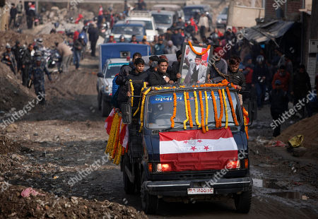 Body of former Nepalese Prime Minister Sushil Koirala, is carried to the Nepali Congress central office in Kathmandu, Nepal, . Koirala, who was a key figure in the drafting and adoption of the country's new constitution in 2015, died Tuesday at the age of 78