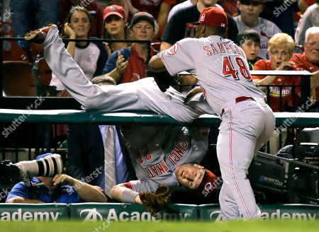 Stock Picture of Todd Frazier, Keyvius Sampson. Cincinnati Reds third baseman Todd Frazier, left, is held back from falling further into a photo pit by teammate Keyvius Sampson after catching a foul ball hit by St. Louis Cardinals' Matt Adams for an out during the fourth inning of a baseball game, in St. Louis
