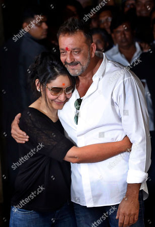 Sanjay Dutt, Manyata. Bollywood actor Sanjay Dutt, right, hugs his wife Maanyata after arriving at his residence in Mumbai, India, . Actor Dutt walked free Thursday after completing his five-year prison sentence for illegal weapons possession in a case linked to the 1993 terror attack in India's financial capital Mumbai