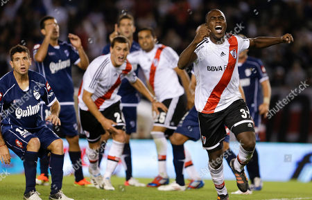 River Plate's Eder Alvarez Balanta, right, celebrates scoring against Quilmes during an Argentina's league soccer match in Buenos Aires, Argentina