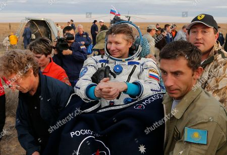 Rescue workers carry Russian cosmonaut Gennady Padalka after the Russian Soyuz TMA-16M capsule carrying a crew of Padalka, Andreas Mogensen of the European Space Agency and Kazakhstan's Aidyn Aimbetov landing some 146 kilometers (90 miles) southeast of town of Dzhezkazgan, Kazakhstan, early