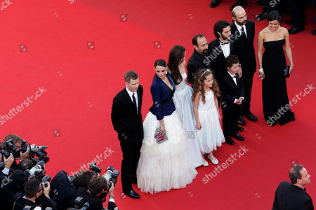 From left, producer Alexandre Mallet-Guy, actress Berenice Bejo, actress Pauline Burlet, actress Jeanne Jestin, director Asghar Farhadi, actor Elyes Aguis, actor Tahar Rahim, actor Ali Mosaffa and actress Sabrina Ouazani pose for photographers as they arrive for the screening of the film The Past at the 66th international film festival, in Cannes, southern France