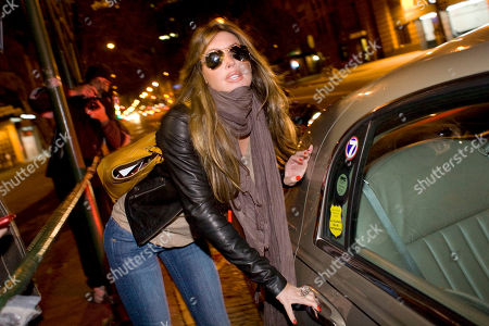 Rachel Uchitel gets into a car in front of her home in New York, . The National Enquirer published a story alleging that golfer Tiger Woods, who was involved in a car accident near his home on Friday, had been seeing the New York night club hostess, and that they recently were together in Melbourne, where Woods competed in the Australian Masters. Uchitel denied having an affair with Woods when contacted by the Associated Press