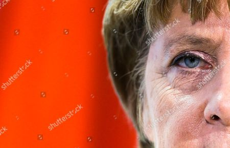Stock Picture of German Chancellor Angela Merkel briefs the media after a meeting the President of the Yemen Abd Rabbuh Mansur Al-Hadi, unseen, at the chancellery in Berlin
