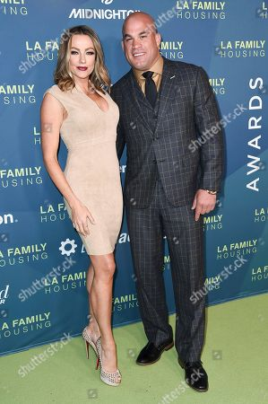 Stock Picture of Amber Nicole Miller, Tito Ortiz. Amber Nicole Miller, left, Tito Ortiz attend the 2018 LA Family Housing Awards at The Lot Studios, in West Hollywood, Calif