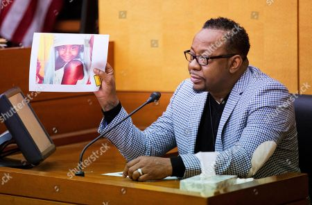 Bobby Brown holds up a picture of his daughter, Bobbi Kristina Brown, during a wrongful death case against her partner, Nick Gordon, in Atlanta, . Bobbi Kristina, the daughter of singers Brown and Whitney Houston, was found face-down and unresponsive in a bathtub in her suburban Atlanta townhome in January 2015