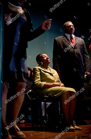Christine King Farris, seated, sister to Rev. Martin Luther King Jr., listens as members of the Southern Christian Leadership Conference break into song following a news conference calling for the reinstatement of her son Isaac Farris, not pictured, former president of the SCLC, in Atlanta. Farris says he was dismissed from the civil rights group without warning or a chance to rebut any reasons for his ouster. Farris spoke publicly Monday for the first time since the board dismissed him in April from the organization co-founded by his uncle, the Rev. Martin Luther King, Jr., and called for unity