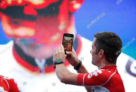 Stock Photo of New Zealand's Greg Henderson takes a selfie during the official team presentation two days before the start of the Tour de France cycling race in Sainte-Mere-Eglise, France