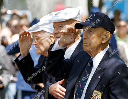 Surviving Doolittle Raider Richard E. Cole, right, salutes during the singing of the national anthem at a memorial service for the the 70th anniversary of the Doolittle raid on Tokyo at the National Museum of the United States Air Force in Dayton, Ohio . Four survivors took part in the ceremonies including David Thatcher, second from right, Thomas C. Griffin, left, and Edward E. Saylor, not seen
