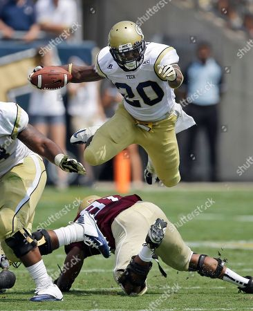 David Sims, Gary Coates. Georgia Tech running back David Sims (20) leaps over Elon defensive lineman Gary Coates (91)during the first quarter of an NCAA college football game in Atlanta