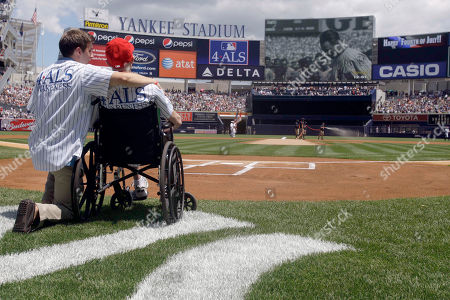 Stock Photo of Michael Goldsmith, right, who suffers from Lou Gehrig's disease, and his son Austin, left, take part in Lou Gehrig Appreciation Day before a baseball game between the Toronto Blue Jays and the New York Yankees, in New York. Goldsmith recently petitioned Baseball Commissioner Bud Selig to begin a 4ALS initiative to raise awareness and funds for ALS, more commonly known as Lou Gehrig's disease