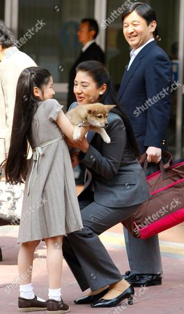 Naruhito, Masako, Aiko. Crown Princess Masako, center, receives family dog Yuri from Princess Aiko with upon arriving at Utsunomiya station with Crown Prince Naruhito in Utsunomiya, north of Tokyo, Japan, . They are on their way to the nearby imperial ranch