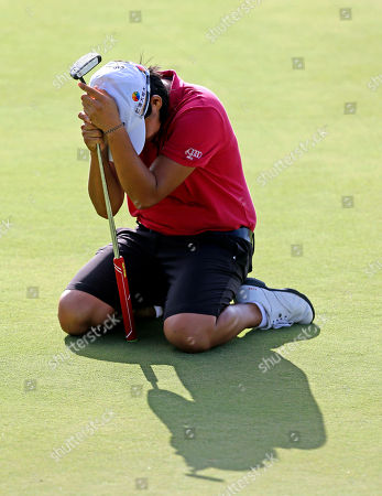 Yani Tseng, of Taiwan, reacts after missing a birdie putt on the 18th green that would have tied her for the lead and force a playoff during the Yokohama Tire LPGA Classic golf tournament, in Prattville, Ala