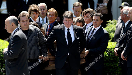 Family and others carry the casket holding Mary Richardson Kennedy, the estranged wife of Robert F. Kennedy Jr., to a hearse after a service at St. Patrick's Church in Bedford, N.Y., . Kennedy was found dead of an apparent suicide this week at her home in Bedford. Robert F. Kennedy Jr., stands just left of center in background, helping carry the casket