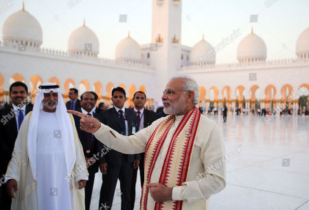 Narendra Modi, Hamdan bin Mubarak Al Nahyan. Indian Prime Minister Narendra Modi, right, visits the Sheikh Zayed Grand Mosque with Sheikh Hamdan bin Mubarak Al Nahyan, UAE Minister of Higher Education and Scientific Research, second left, during the first day of a two-day visit to the UAE, in Abu Dhabi, United Arab Emirates, . The UAE is home to over two million Indian expatriates and this is the first visit by an Indian premier in over three decades