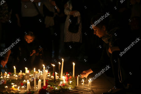 "Iranian women light candles as some hundreds of Iranians attend a candlelit ceremony at Cinema Museum in Tehran, Iran, to mourn the death of film director Abbas Kiarostami, who died at the age of 76 after a career spanning more than four decades. Kiarostami wrote and directed dozens of films, and his 1997 film ""Taste of Cherry"" won the prestigious Palme d'Or at the Cannes Film Festival. He died in Paris, where he was undergoing treatment for cancer"