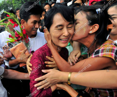 One of the villagers welcoming Myanmar democracy icon Aung San Suu Kyi kisses her as she visits Nyaung Oo market in Nyaung U village, Myanmar, . Suu Kyi was visiting the village with her youngest son Kim Aris and members of the National League for Democracy party