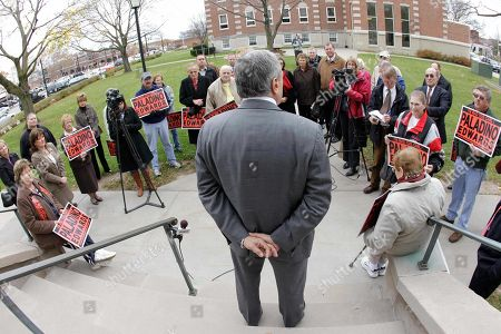 Republican gubernatorial candidate Carl Paladino, back to camera, speaks during a campaign stop, in Batavia, N.Y