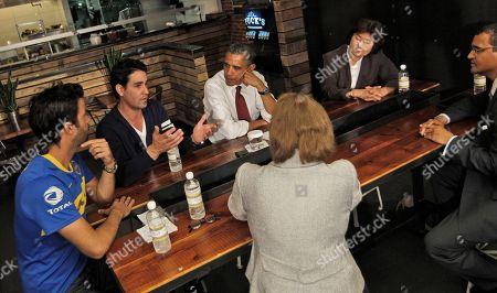 Barack Obama, Karen Mills, David Mazza, Casey Patten, Kathy Rachels, Brian J. Smith. President Barack Obama, and SBA Administrator Karen Mills, sitting across from Obama, participate in a roundtable discussion with local small business owners at Taylor Gourmet in the U Street neighborhood in Washington, . From left are, Taylor Gourmet Co-owners David Mazza, and Casey Patten, the president, Kathy Rachels, President of Yes Organic Market and Brian J. Smith, of Francis Lee Contracting
