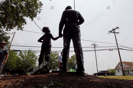 A statue of Andy and Opie Taylor is shown outside the Andy Griffith Playhouse in Mount Airy, N.C., . Andy Griffith, the iconic actor and North Carolina native died Tuesday at the age of 86