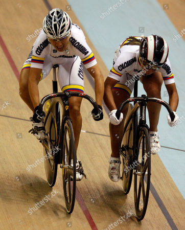 Colombia's Diana Garcia, left, speeds up past Colombia's Juliana Gaviria to win the bronze medal in cycling women's sprint final at Pan American Games in Guadalajara, Mexico