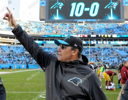 Carolina Panthers head coach Ron Rivera points to his wife in the stands after an NFL football game against the Washington Redskins, in Charlotte, N.C. Panthers coach Ron Rivera was on the hot seat a few years ago, but owner Jerry Richardson showed patience and helped guide Rivera through some growing pains. Now, in Year 5, Rivera's Panthers are 15-1 entering Sunday's divisional playoff game against Seattle