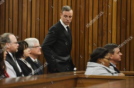 Oscar Pistorius, centre, appears in the High Court for re-sentencing proceedings, in Pretoria, South Africa, . Pistorius appeared in a South African court on Monday for a sentencing hearing after the double-amputee Olympian was convicted of murdering girlfriend Reeva Steenkamp. Defense lawyer Barry Roux argued for some leniency and called a psychologist who evaluated Pistorius to testify