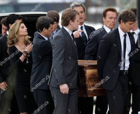 Anthony Shriver, Maria Shriver, Arnold Schwarzenegger. The casket of R. Sargent Shriver is carried into Our Lady of Mercy Catholic Church for a funeral Mass in Potomac, Md., just outside Washington, . Shriver, the man responsible for launching the Peace Corps after marrying into the Kennedy family, died last Tuesday at the age of 95 after suffering from Alzheimer's disease for years. His son, Anthony Shriver, is at far right. His daughter, Maria Shriver, is at left, joined by her husband, actor and former California Governor Arnold Schwarzenegger, second from right