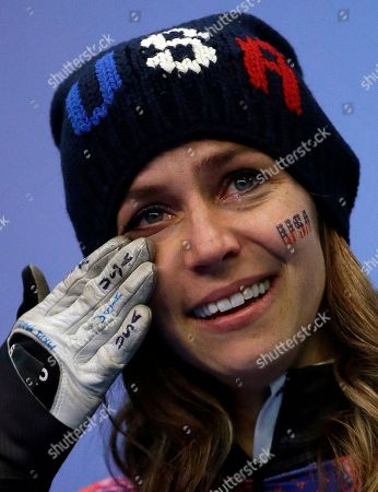 Noelle Pikus-Pace of the United States cries during the flower ceremony after winning the silver medal during the women's skeleton competition at the 2014 Winter Olympics, in Krasnaya Polyana, Russia