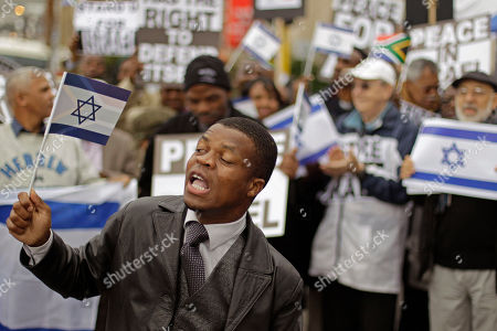 A Jewish supporter shout out during a protest against a proposal from South African trade minister Ron Davies in Cape Town, South Africa, . Around two hundred Jewish supporters gathered in front of parliament to demonstrate against a proposal form South African Trade and Industry Minister Rob Davies, to label goods originating from Israel as 'Made in Occupied Palestinian Territory