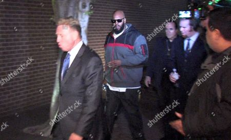 "In this file image from video, Death Row Records founder Marion ""Suge"" Knight, right, walks into the Los Angeles County Sheriffs department in the early morning in connection with a hit-and-run incident that left one man dead and another injured. Knight, had his $2 million bail revoked in Los Angeles after his arrest in running down and killing a man. Los Angeles County sheriff's spokeswoman Nicole Nishida says detectives asked a bail commissioner Monday, Feb. 2, 2015, to keep Knight behind bars because he is a possible flight risk"