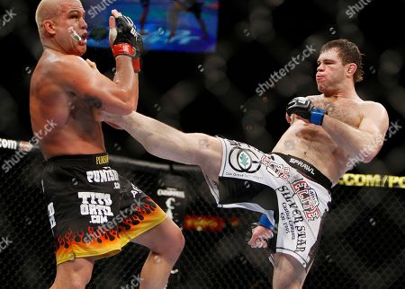Tito Ortiz, Forrest Griffin. Forrest Griffin, right, kicks Tito Ortiz during their mixed martial arts light heavyweight bout, in Las Vegas. Griffin won by split decision