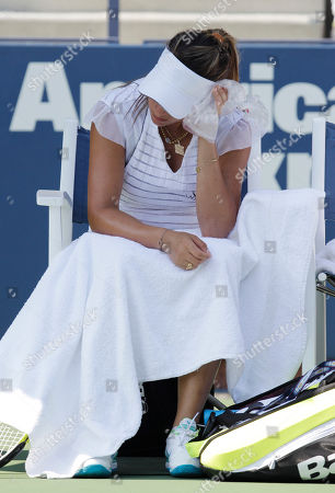 Aravane Rezai of France holds ice to her head as she rests between sets while playing Beatrice Capra of the United States at the U.S. Open tennis tournament in New York, . Capra beat Rezai 7-5, 2-6, 6-3