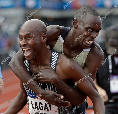 Bernard Lagat, left, celebrates his win in the finals of the men's 5000-meter run with Paul Chelimo at the U.S. Olympic Track and Field Trials, in Eugene Ore