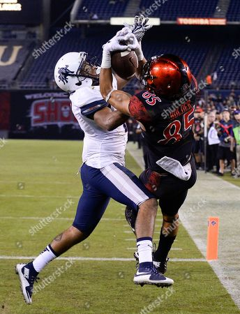 Chase Price, Robert Craighead. San Diego State wide receiver Mikah Holder (85) fights for a pass in the end zone with Utah State cornerback Deshane Hines (17) during the second half of an NCAA college football game, in San Diego. Holder was unable to make the catch