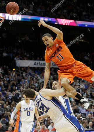 Virginia Tech guard Erick Green (11) loses the ball as Duke forward Miles Plumlee (21) defends during the first half of an NCAA college basketball game in the quarterfinals of the Atlantic Coast Conference tournament, in Atlanta